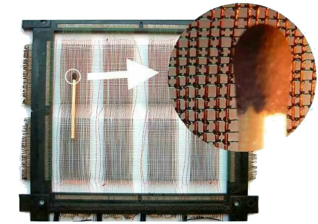 Photography illustrating the size of a core memory in contrast to a match
